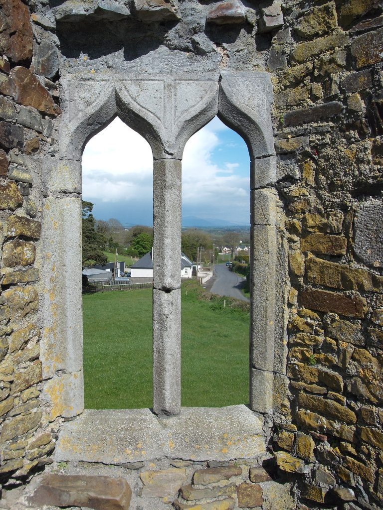 Square two-light ogee-headed window which dates to approximately the 16th Century.